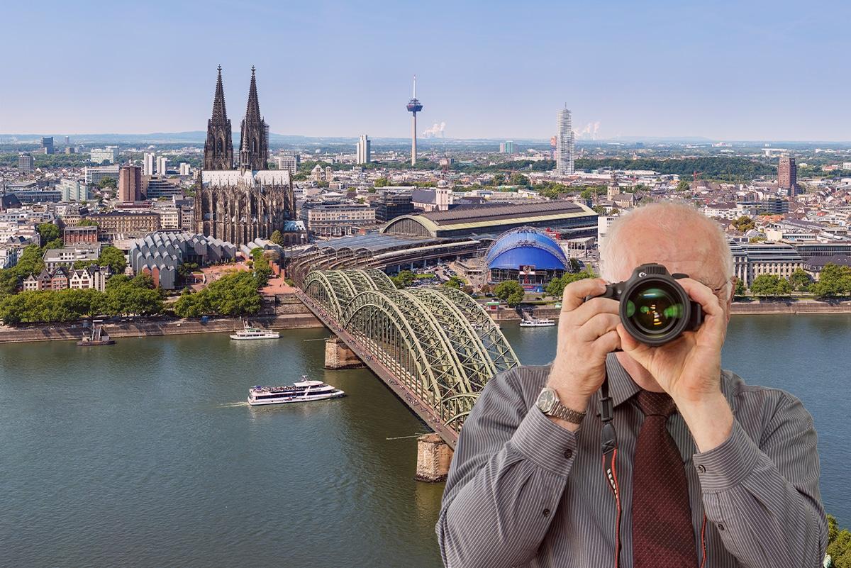 Detektiv steht vor dem Kölner Dom. Detektei Köln ermittelt. Detektiv fotografiert