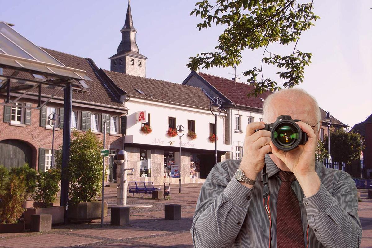 Innenstadt Jüchen, Detektiv zeigt Daumen nach oben, Schriftzug: Unserer Detektei ermittelt für Sie in Jüchen !